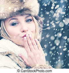 Winter Blond Hair Woman in Fur Hat. Beautiful Girl Kissing