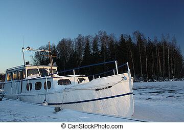 Winter boat in frozen lake