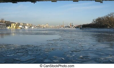 Winter boat ride under Krymsky bridge in Moscow, time lapse