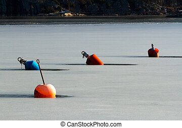 Winter Bouys - Bouys locked into the icy water