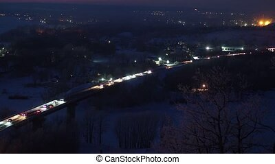 Winter bridge landscape view with car moving at night