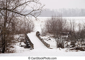 Winter Bridge - A wooden bridge during the snow at Monmouth...