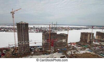 building site, aerial view time lapse - winter, building...