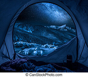 Winter camp in the mountains at night with stars