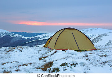 Winter camping - Tent in mountains in the winter