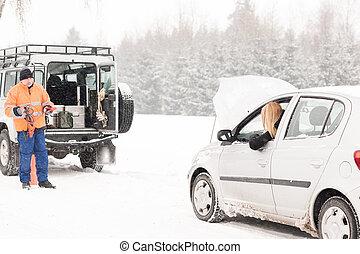 Winter car assistance man help woman breakdown