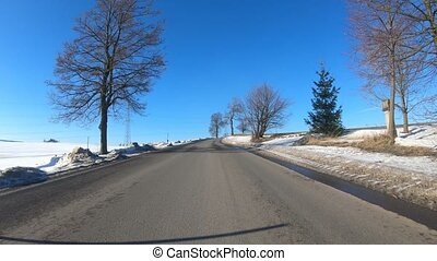 winter car drive in sunny day - Car driving in through...