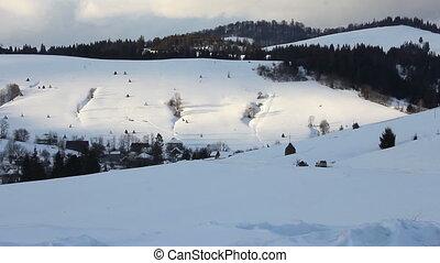 Winter Carpathians landscape with people  sledding on horseback