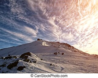 Winter Carpathians. Old Polish observatory on Mount Pop Ivan, 2022 meters.