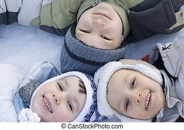 winter children - three children on snow