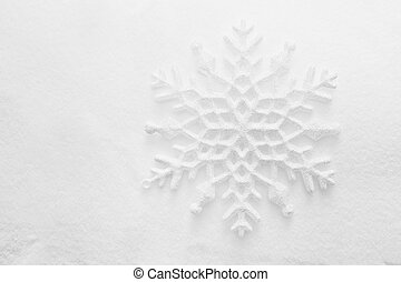 Winter, Christmas minimal elegant background. Snowflake on snow, low contrast image.