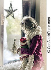 winter christmas concept and girl by the window