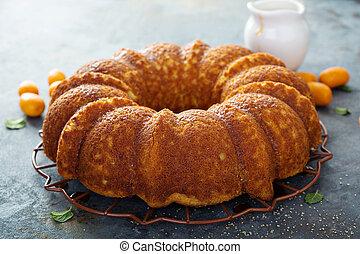 Winter citrus pound bundt cake with orange zest maple cirup