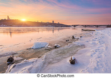 Winter city of Kiev at night on river