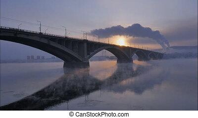 winter cityscape, the automobile bridge in the backlight, time lapse