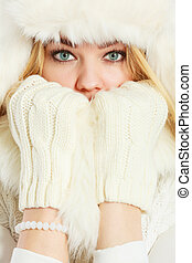 Blonde woman with fur cap.