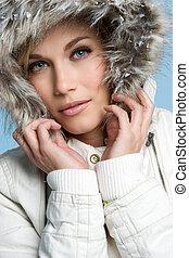 Beautiful woman wearing winter coat
