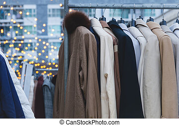 Winter coats hanged on a clothes rack.