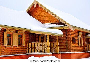 Winter cottage in the village