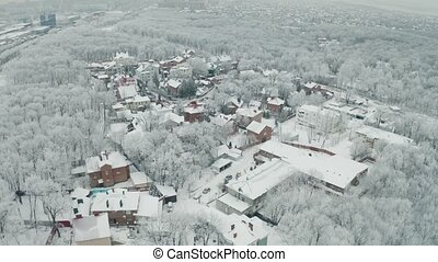 Winter cottage town covered white snow aerial view