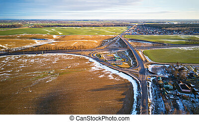 Fields covered with snow. Aerial view. Snow covered farmland