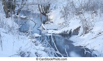 winter creek in the forest snow, frozen branches of trees nature landscape