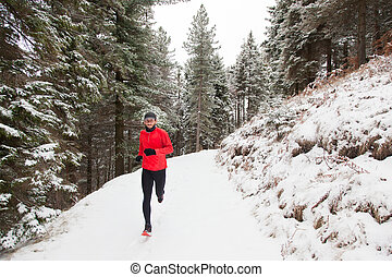Winter Cross-country Running - Winter trail running: man...