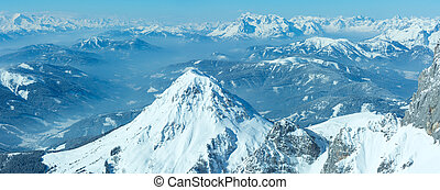 Winter hazy view from Dachstein mountain massif top to Schladming and Filzmoos region (Austria).