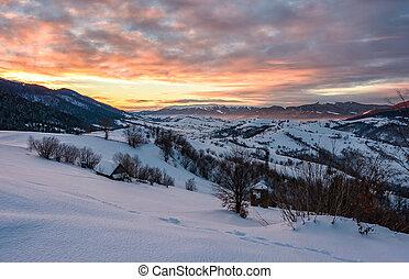 winter dawn in mountainous countryside. gorgeous cloudy sky...