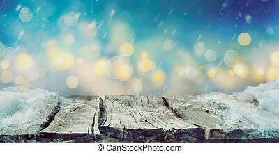 Winter design - Frozen wooden table with bokeh