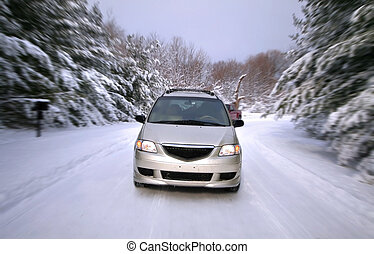 Driving on snow covered road in winter time
