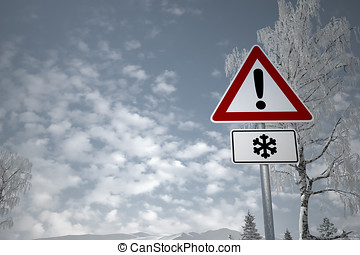 Winter Driving - Caution Snow - Warning sign in front of a...