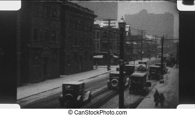 Winter driving in the city. 1920s.