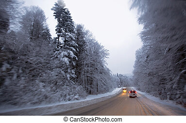 Winter driving on country road.