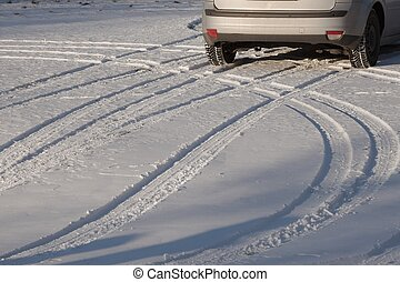 Winter driving - Wheel of a car on snow