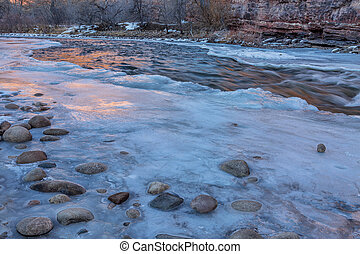winter dusk over mountain river