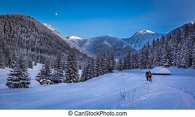 Winter expedition in the mountains at sunset