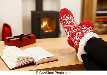 Winter feet in front of fire