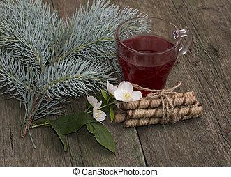 winter festive card, tea, fir-tree branch, cookies and flower