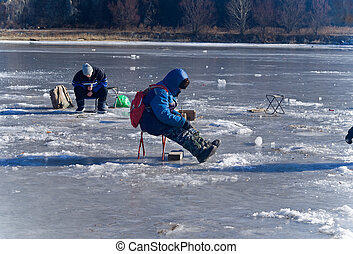 Winter Fishing 43 - A winter fishing on river. People is ...