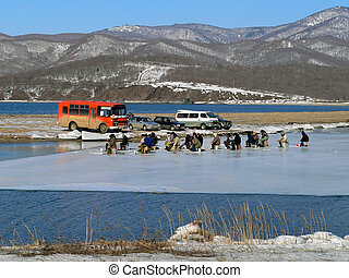 Winter Fishing 7 - A group of the fishers is on ice cake. ...