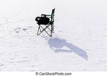 winter fishing jig on frozen lake