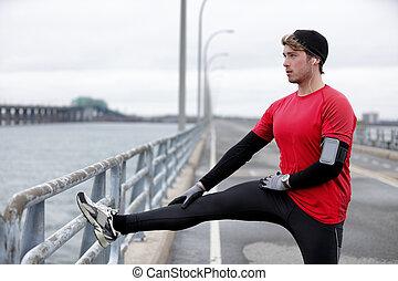 Winter fitness running man warm-up stretching legs
