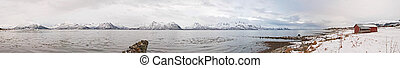 Winter fjord - Fjord with red house and snow during the...
