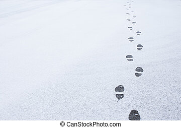 Winter foot steps in the snow on the ground
