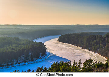 Winter Forest and River in the Sunset Background