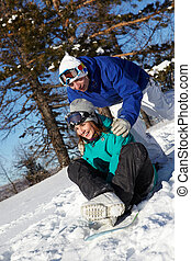 Winter fun - Portrait of happy dates snowboarding during ...
