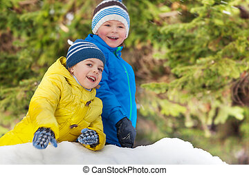 Winter fun with snow two smiling little boys