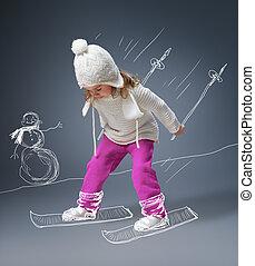 winter game - a beautiful child enjoying life
