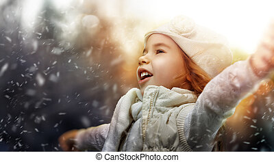 winter games - a beautiful child enjoying winter